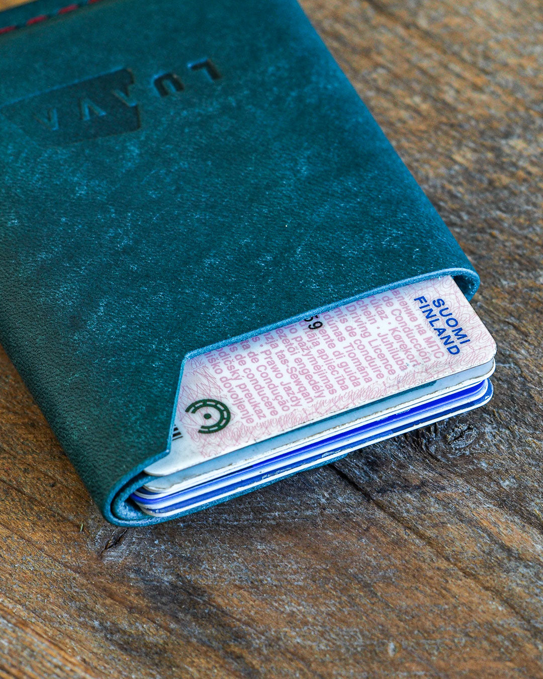 Luava handmade leather wallet handcrafted card holder wrap cardholder made in finland vortex maya turquoise back in use angle close up