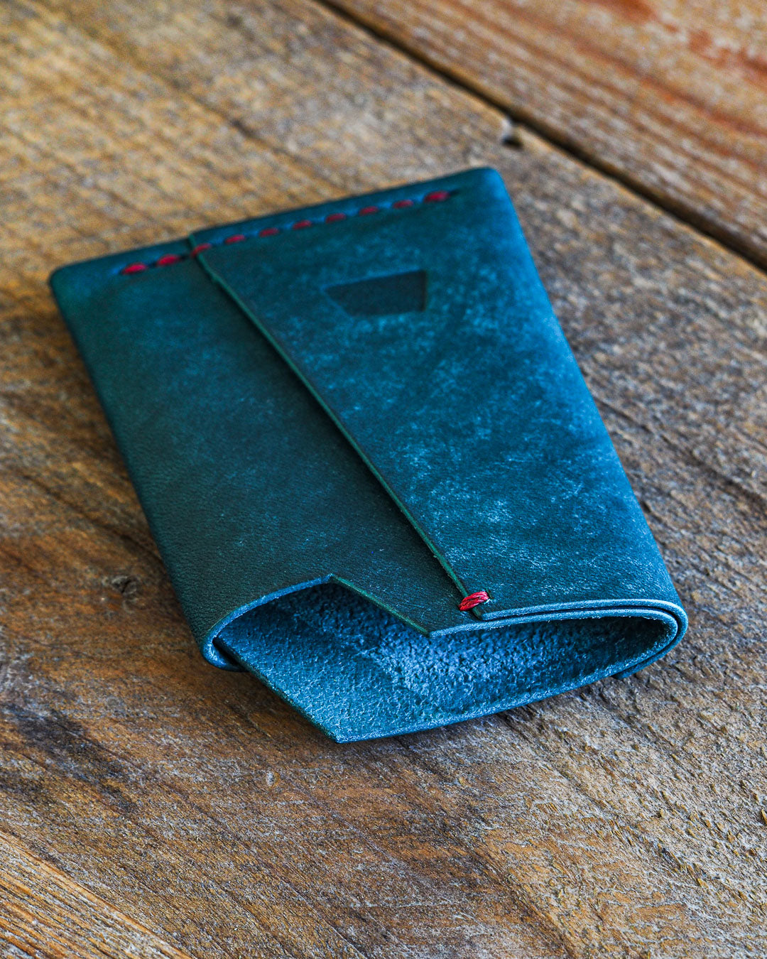 Luava handmade leather wallet handcrafted card holder wrap cardholder made in finland vortex maya turquoise front angle close up