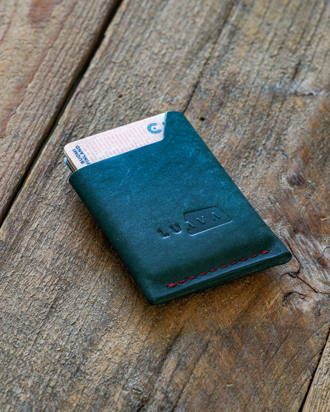 Luava handmade leather wallet handcrafted card holder wrap cardholder made in finland vortex maya turquoise back in use angle