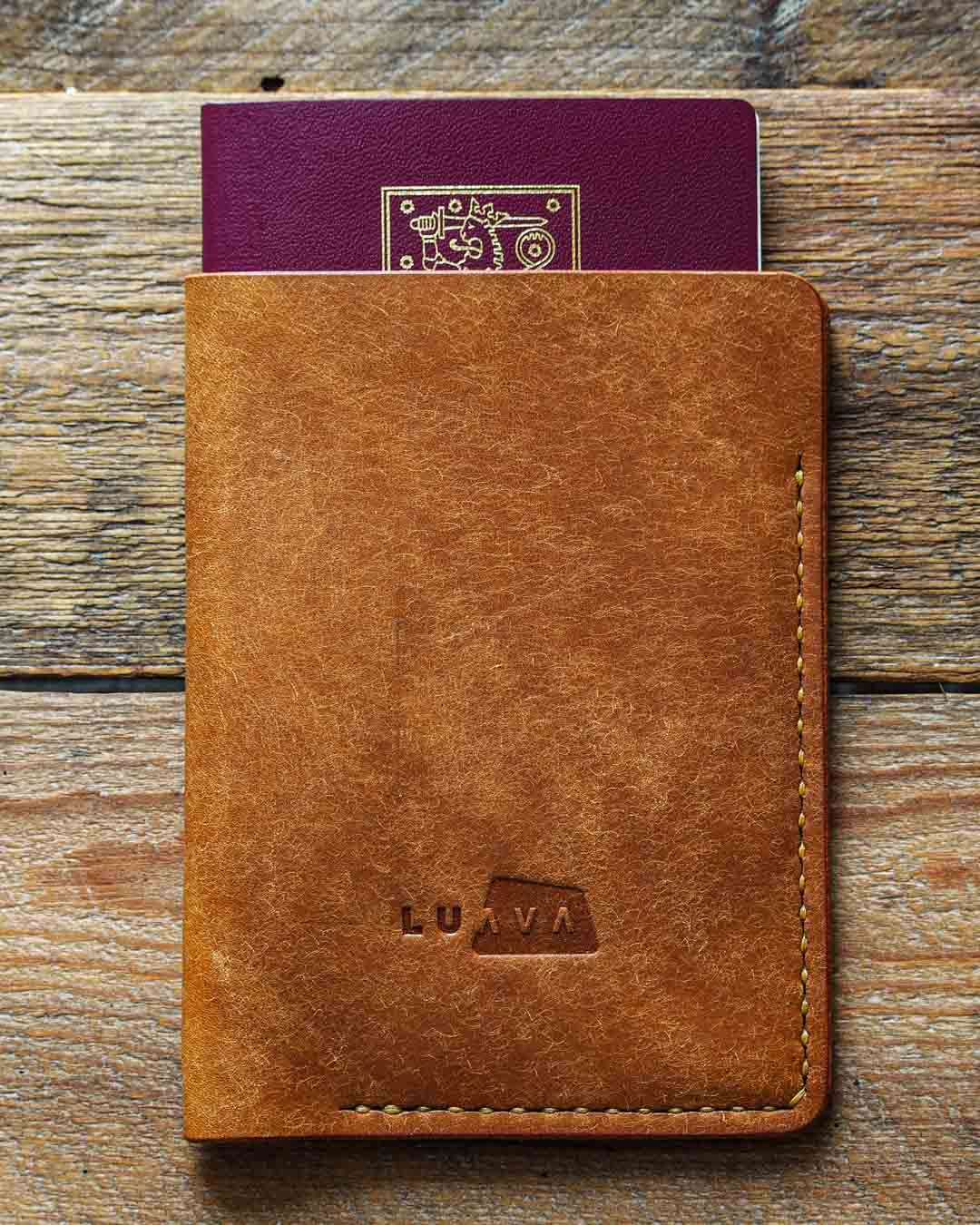 Luava handcrafted leather passport cover pueblo cognac in use