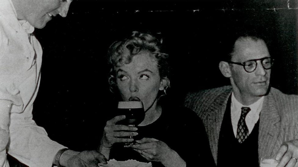 Marilyn Monroe sips an Irish Coffee