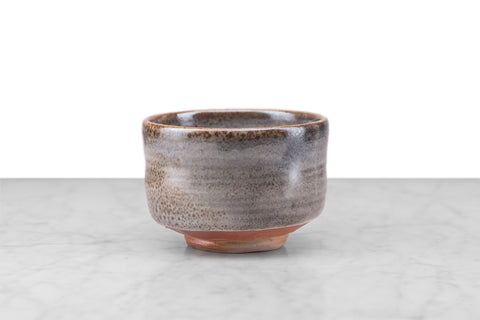 matcha chawan deep bowl with smooth, slightly curved sides in a grey and brown glaze