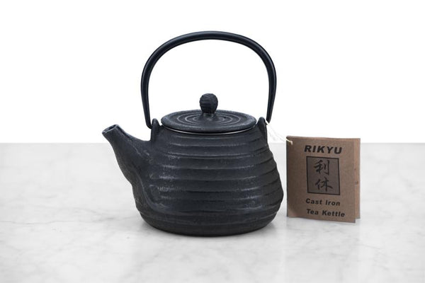 small cast iron teapot in a beehive shape
