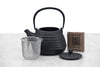 small cast iron beehive teapot with infuser basket and lid displayed separately