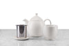 off-white tea set including teapot, infuser basket, infuser rest, and handleless tea cup