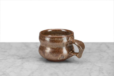hand thrown local NY pottery brown tea or coffee mug with beveled sides and a thumbprint handle