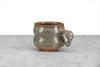 hand thrown coffee or tea mug in greenish gray glaze