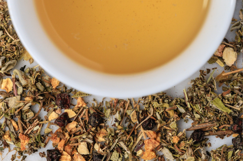 happy hour anti-anxiety tea blend surrounding cup of happy hour tea