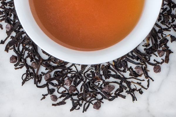 Long Luxurious Black Tea Leaves and Tiny Pieces of Dark French Chocolate Surrounding A Velvety Cup of Vanilla Bean and Chocolate Scented Tea