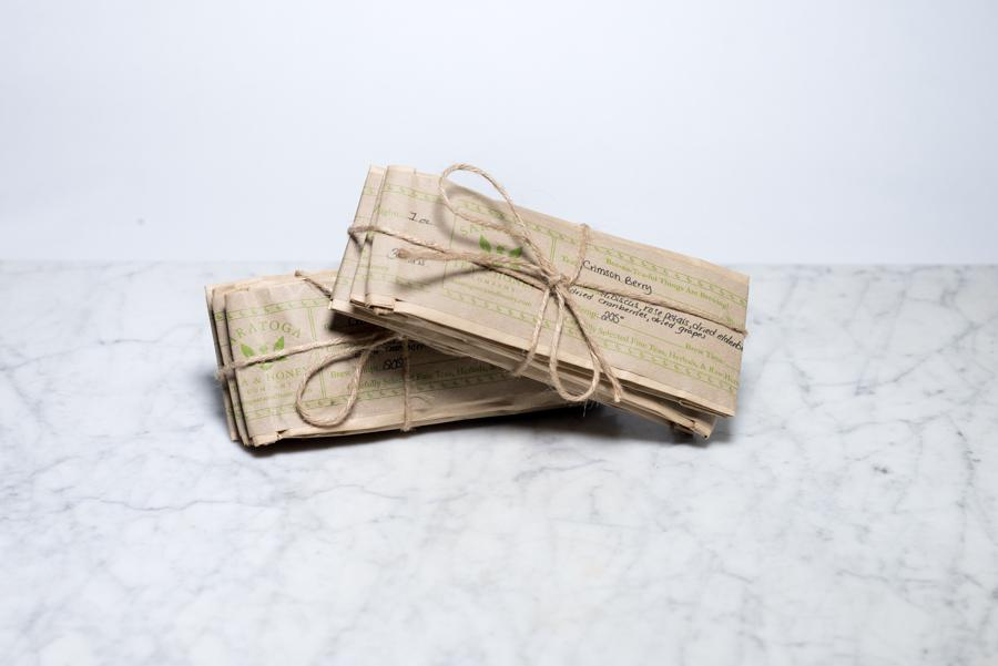 Brown Paper Tea Packages Tied Up with String