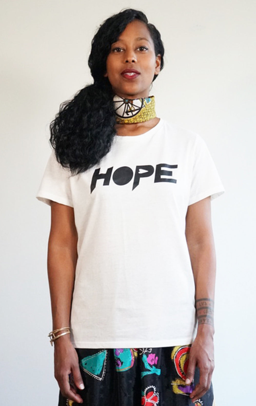 white tee with super soft hope print graphic Tshirt in a cool crew neck style made in a soft cotton blend with hope graphic on front