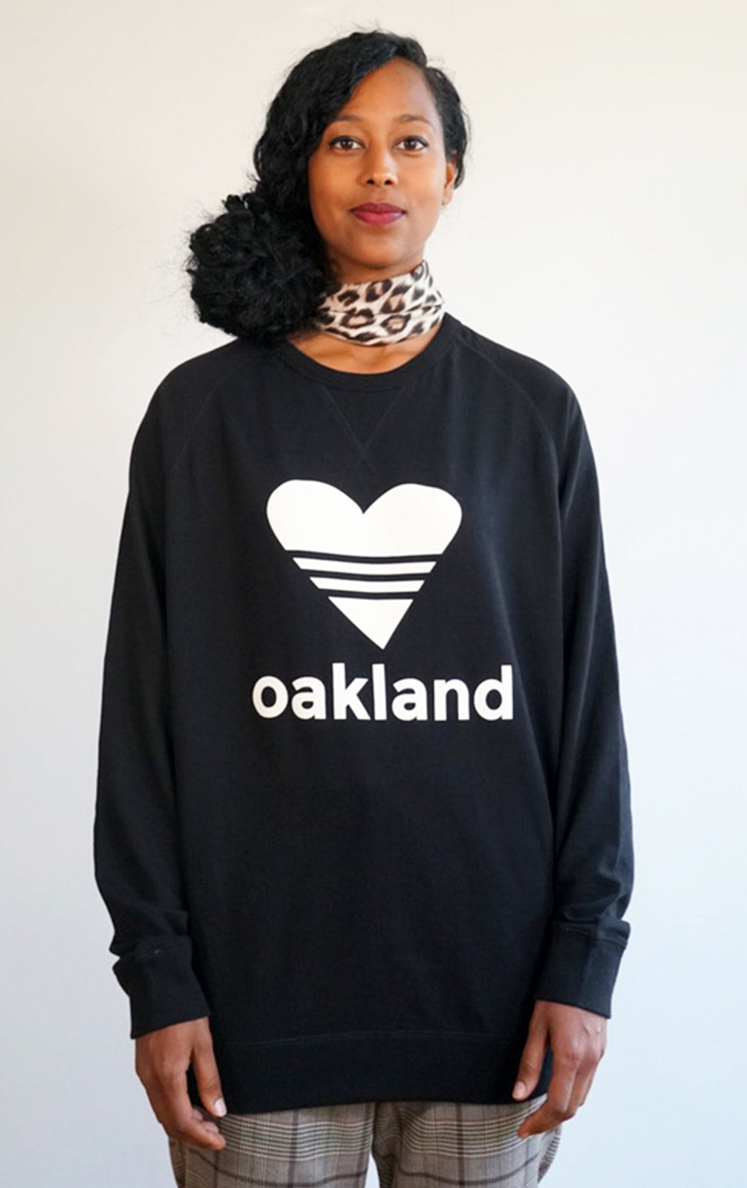 black super soft love oakland sweatshirt in a cool crew neck style made in a soft cotton blend with love oakland heart graphic on front