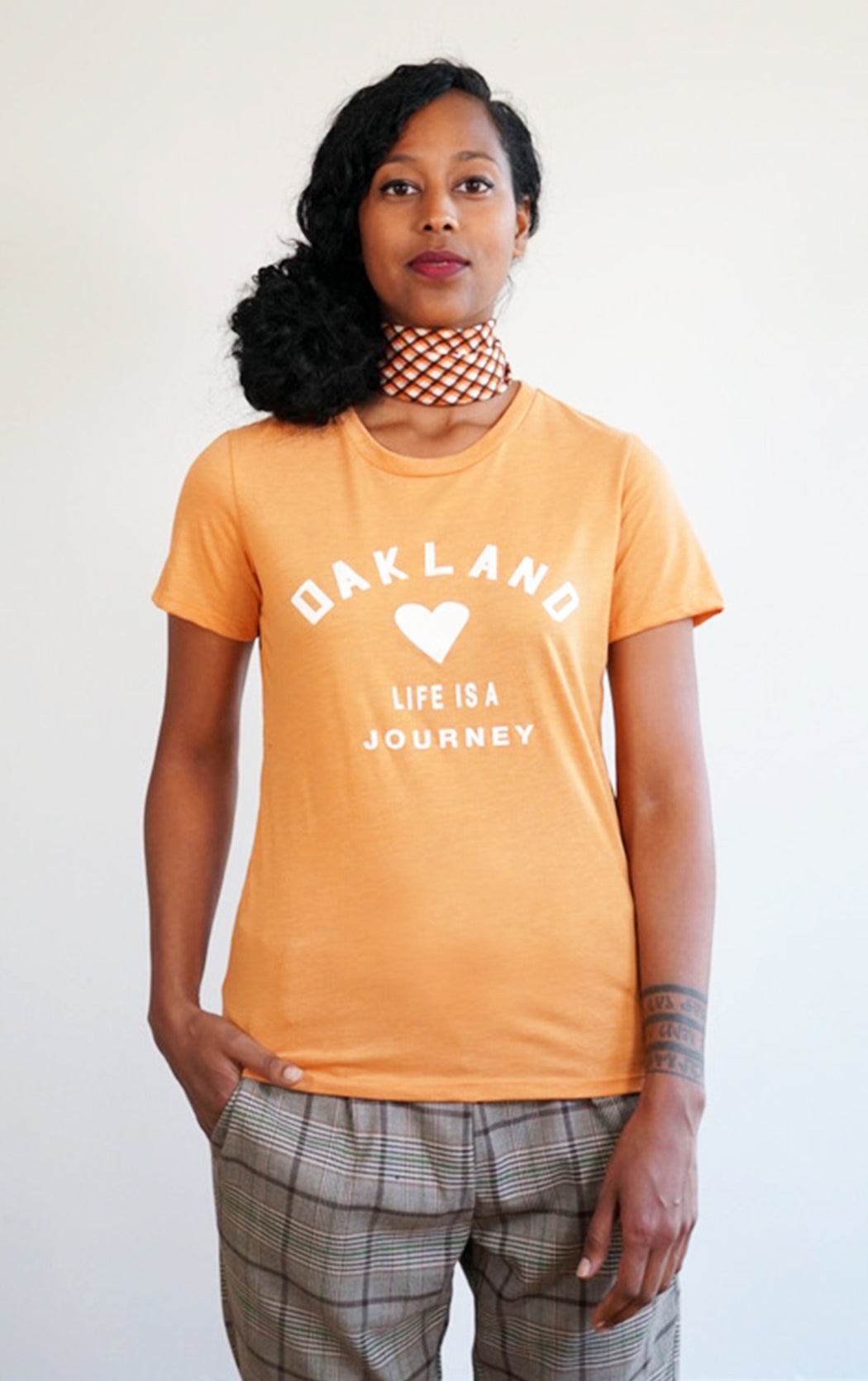 burnt orange tee with super soft love oakland print graphic Tshirt in a cool crew neck style made in a soft cotton blend with oakland old skool  graphic on front