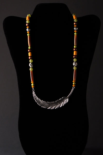 Curved Earth Feather Necklace by Michelle