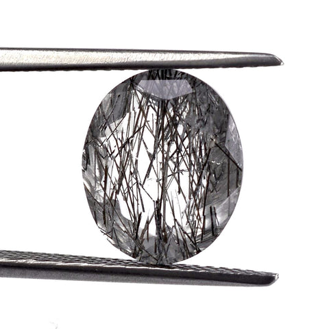 Black rutile quartz oval 12x10mm cut gemstone