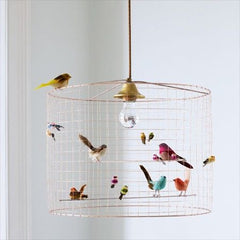 bird cage chandelier with little birds on it