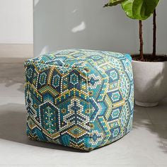 blue and green patterned pouf