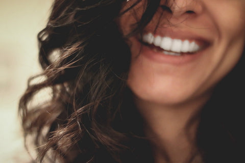 Close-up of a woman smiling by Les Jay