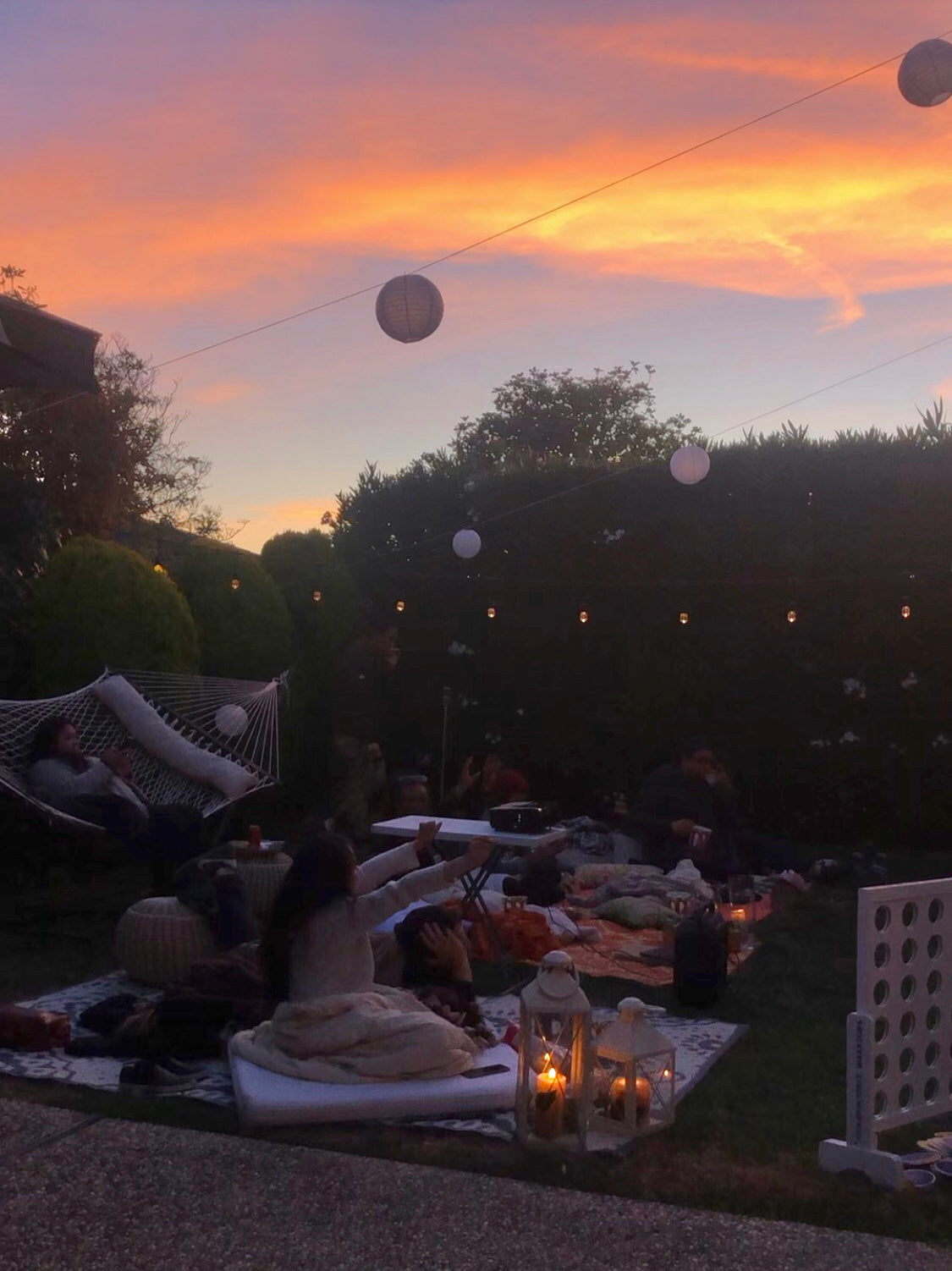 Sunset for Outdoor Movie Night Birthday Party - Boho Birthday - Backyard Movie Night at Sunset - Pretty Collected