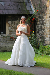 A line Wedding Dress with Beaded detail and a Long Train - Cerrura Fashions