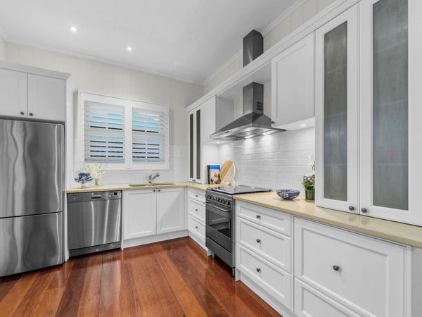 Hamptons style kitchen renovation of worker's cottage in Clayfield