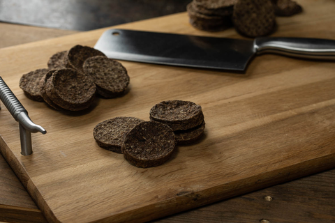beef dog treats on cutting board with knife