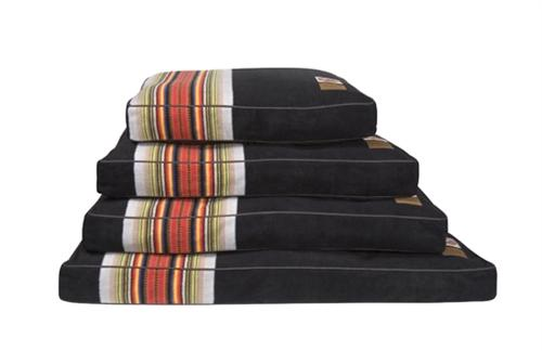 stack of acadia dog beds, the colors are brown, green, yellow, red, orange, blue, black