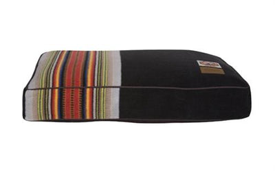 a single acadia dog bed, the colors are brown, green, yellow, red, orange, blue, black