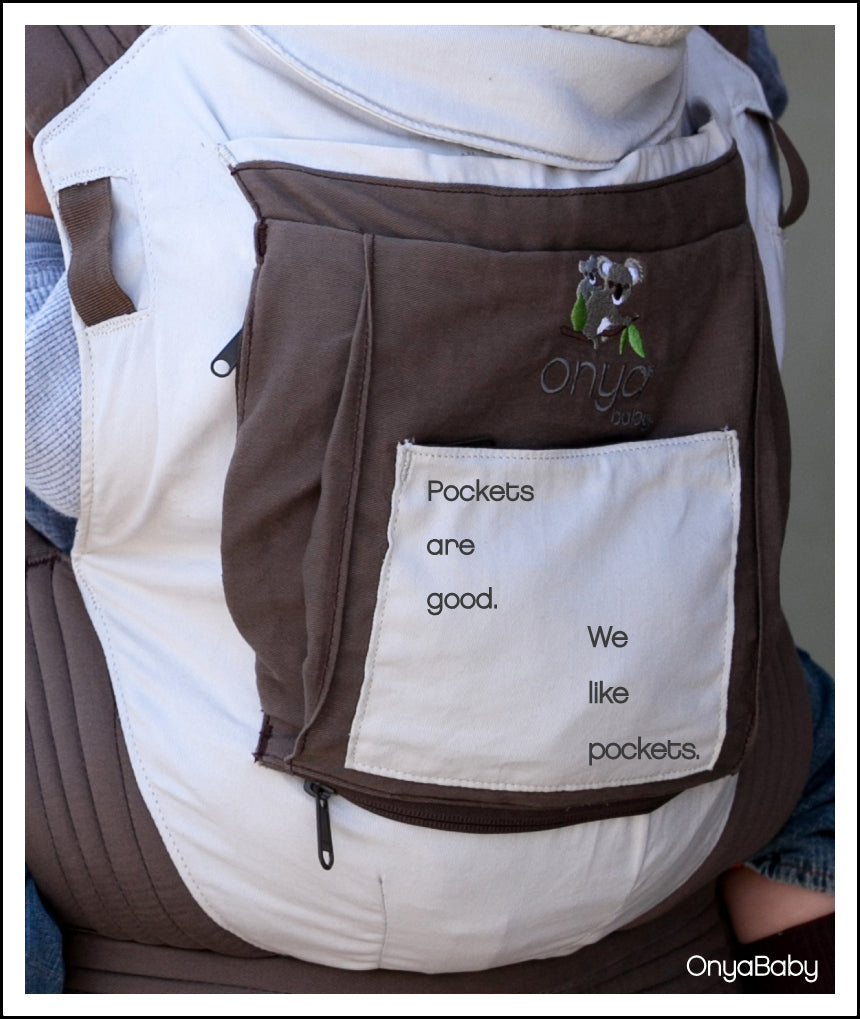 Close up photo of an Onya Baby Carrier showing details