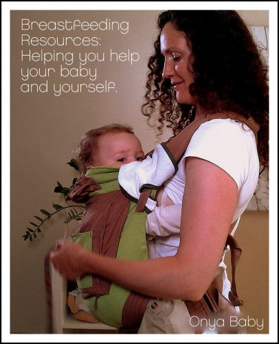 Mother breastfeeding in a baby carrier