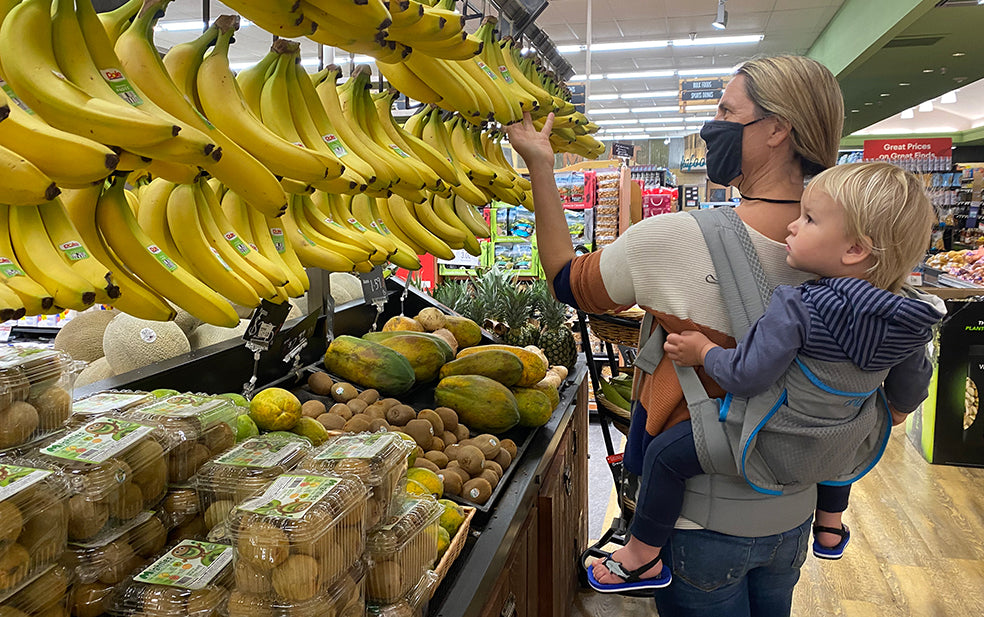 Parent shopping with baby in Onya carrier
