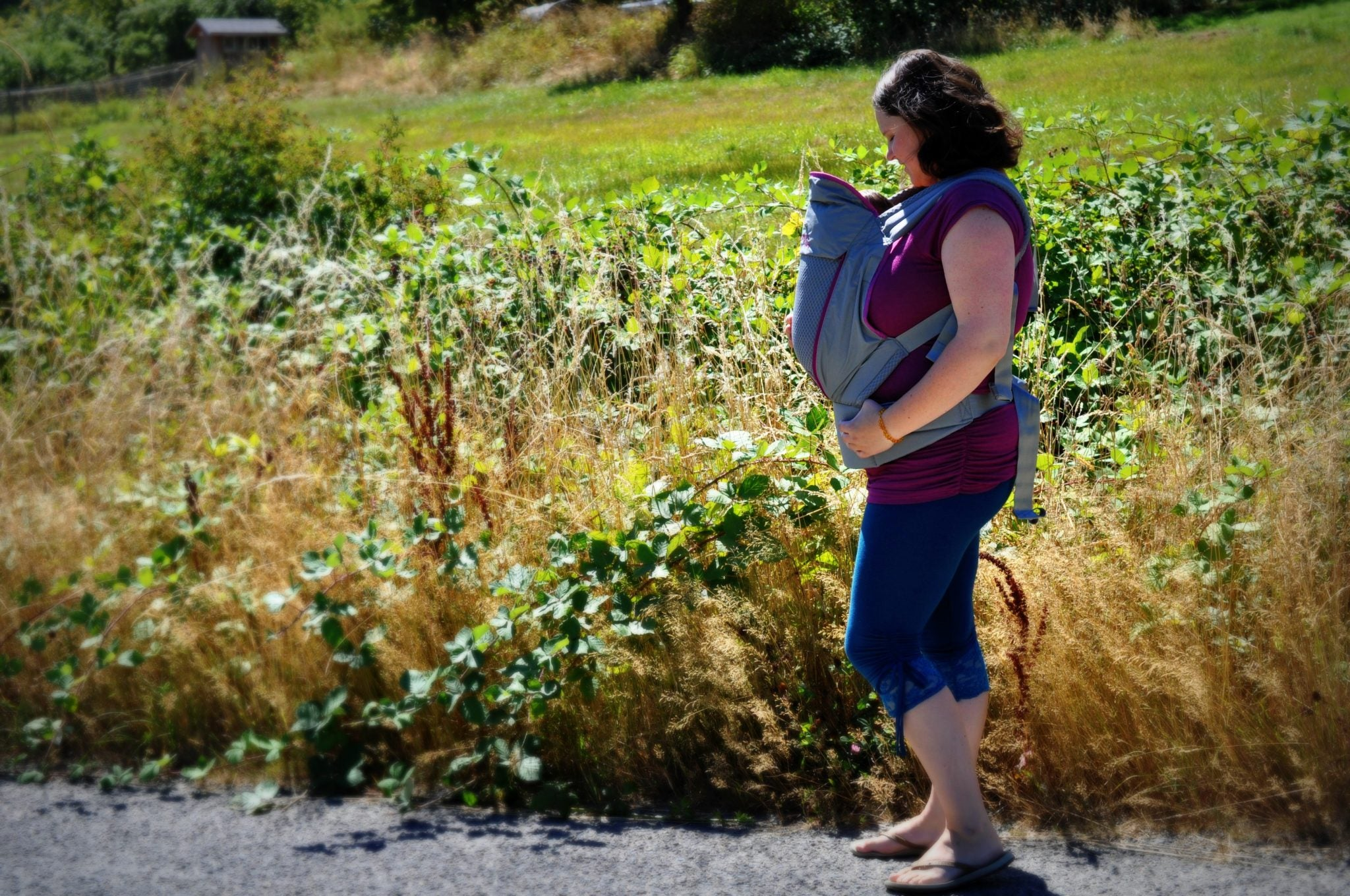 Mother out for a walk with baby in Onya carrier