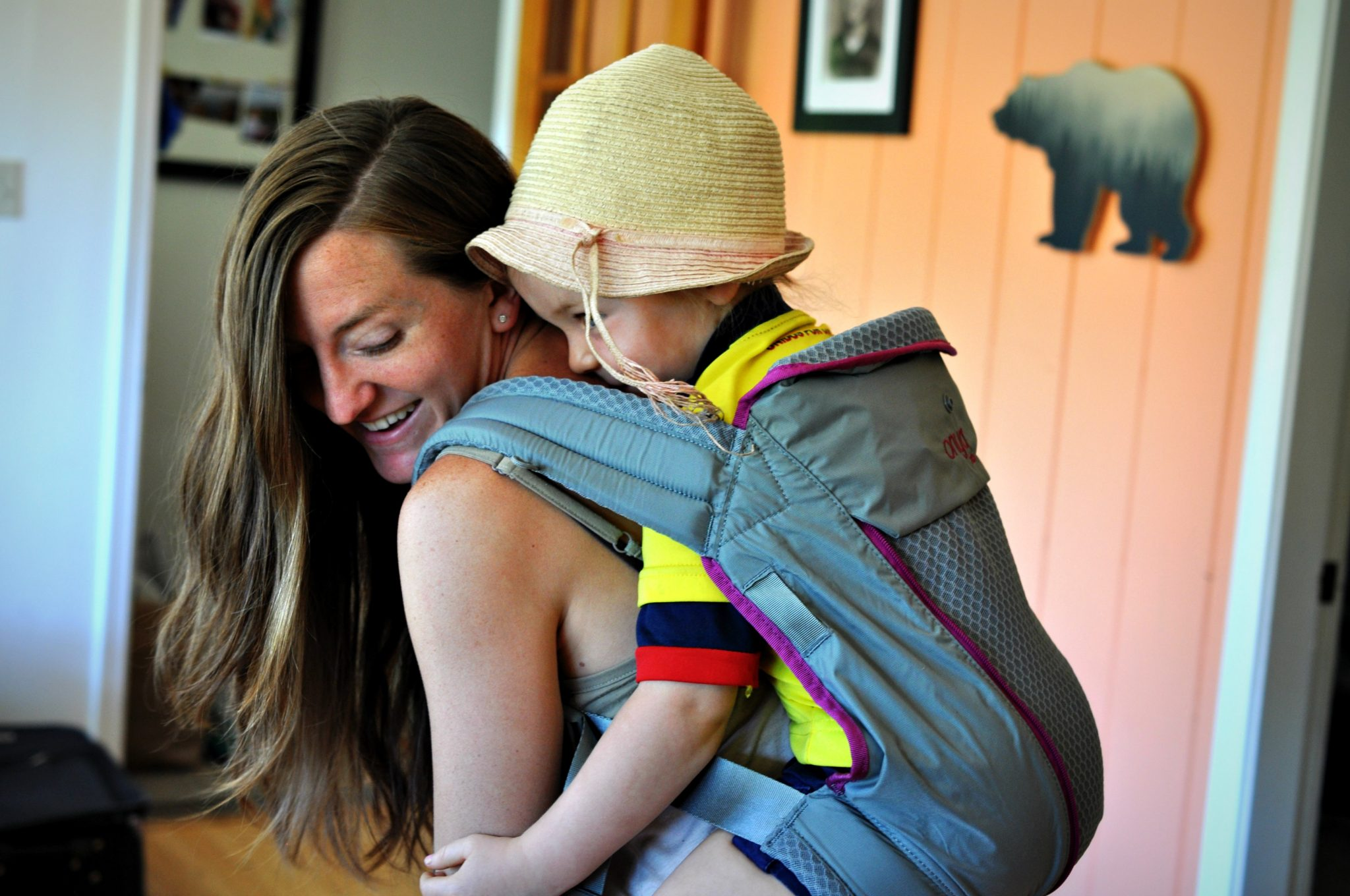 Mother laughing with baby in Onya Carrier