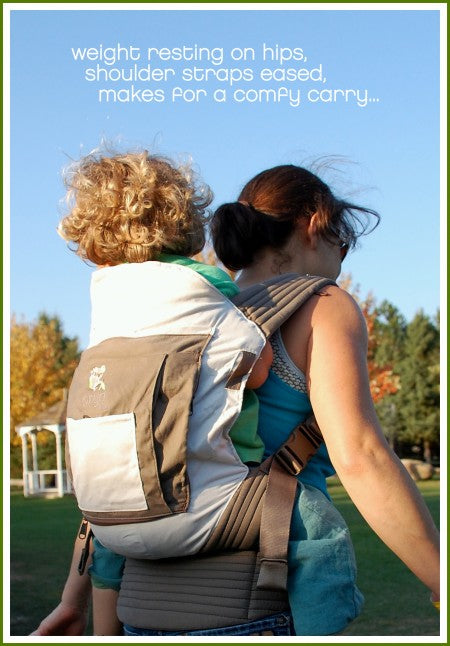 Mother demonstrating proper back carry with child in Onya Baby Carrier