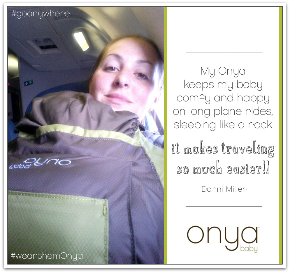 Mother with child in Onya Baby carrier on a plane