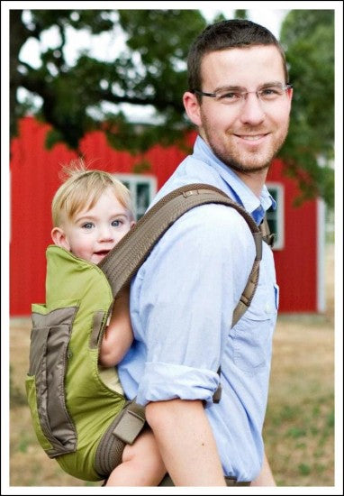 Dr Andrew with his son in an Onya Baby carrier