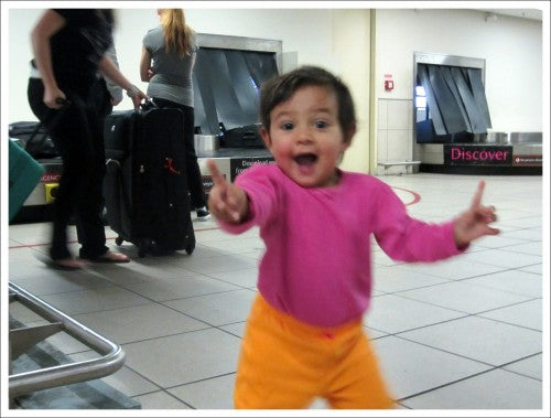 Happy baby smiling at the airport ready for travel