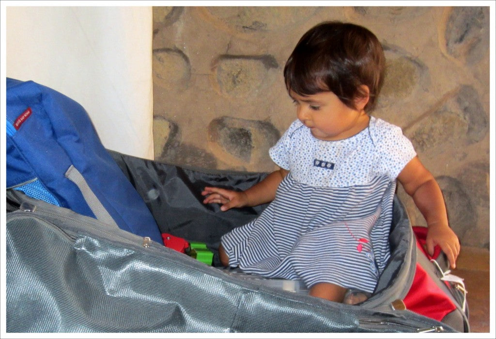 Child helping mom pack for a travel trip