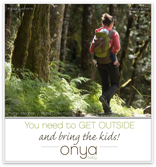 Parent hiking outside with baby on back in Onya Baby Carrier