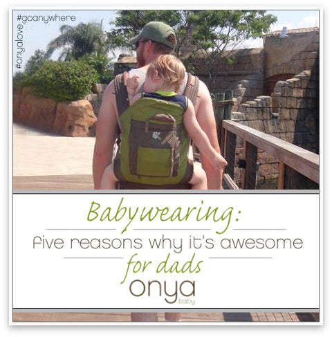 Dad wearing son in back-carry position in an Onya Baby Carrier