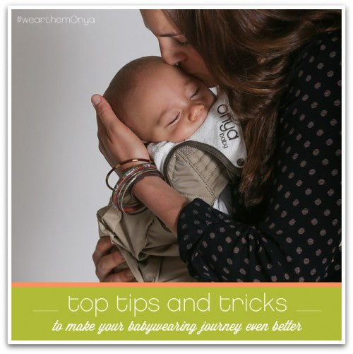 Mother gently kissing baby in her Onya Baby Carrier
