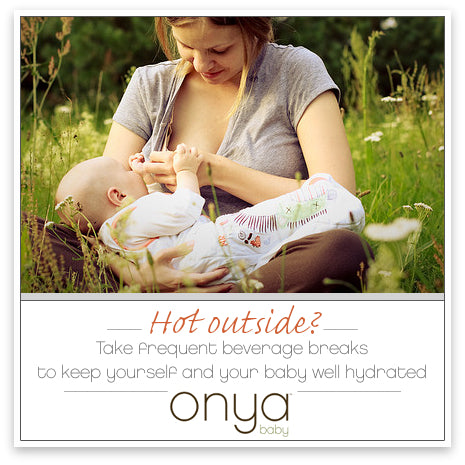 Mother breastfeeding child in Onya Baby Carrier