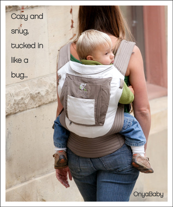 Mother back carrying child in Onya Baby Carrier