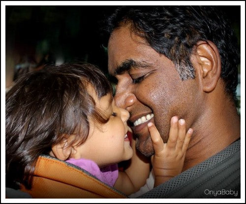 Father smiling and laughing with daughter