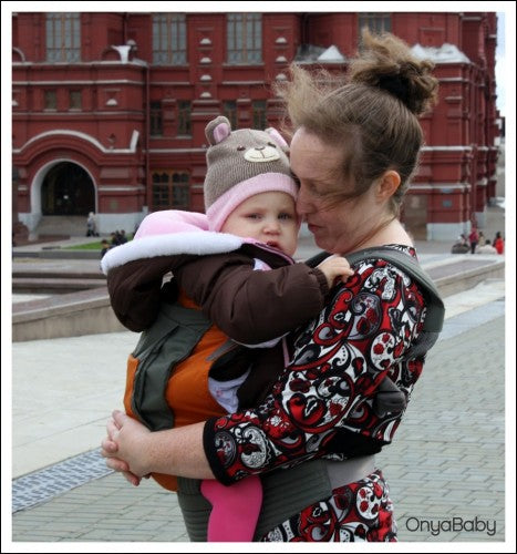 Mother kissing baby in an Onya Baby Outback Carrier