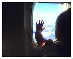 Child traveling with parents in plane