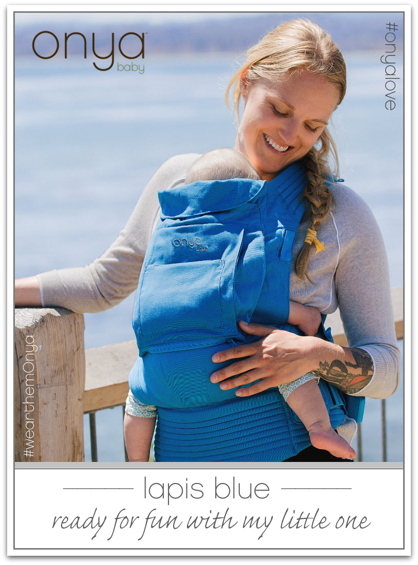 Woman carrying baby in Lapis Blue Onya Baby Cruiser