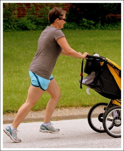 Parent doing baby carrier exercises