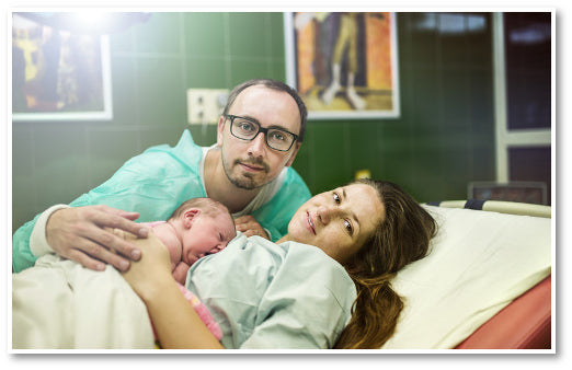 Proud parents with newborn baby in hospital