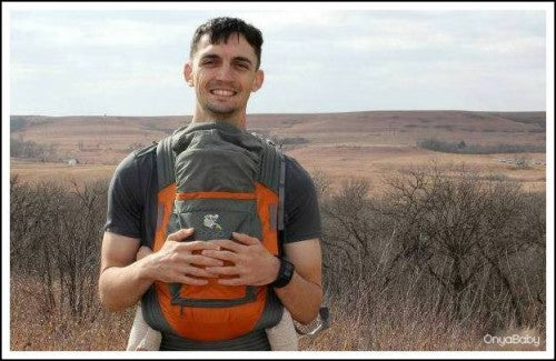Father wearing baby in front-carry-position in an Onya Baby Outback Carrier